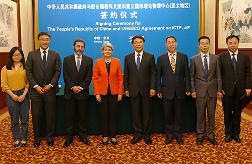 ICTP Director Fernando Quevedo (third from left) with UNESCO Director-General Irina Bokova (center) and Chinese Academy of Sciences President Chun-Li Bai (center) at signing of agreement to establish ICTP-AP